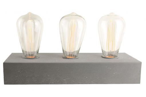 ! La lampe à poser Eureka avec ses trois ampoules et son socle en béton
